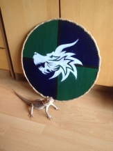 This wooden shield needed a proper emblame on it. Approved by the bearded dragon!